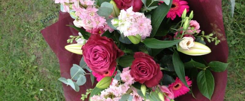 Bouquet of flowers with vibrant reds & pinks